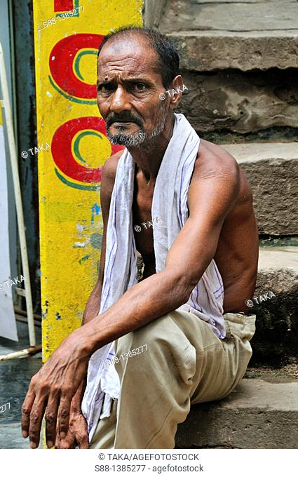 Man sitting on the back street quietly