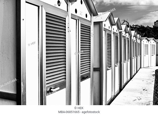 lateral view to several changing rooms on the beach, architecture on the beach of Lignano