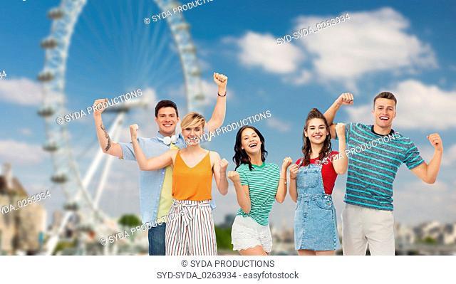 happy friends making fist pump over ferry wheel