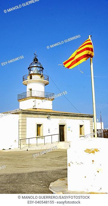 Cap de Creus lighthouse with Catalan flag, Cadaqués, Catalunya, Spain