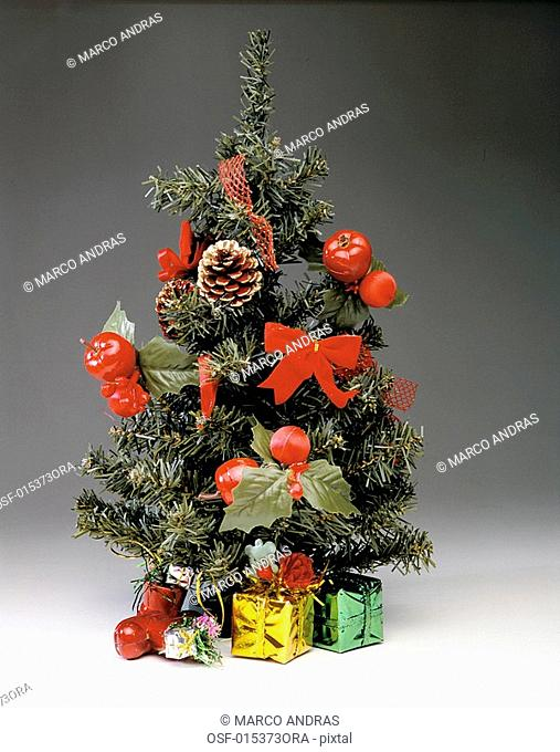 a decorated christmas tree with presents