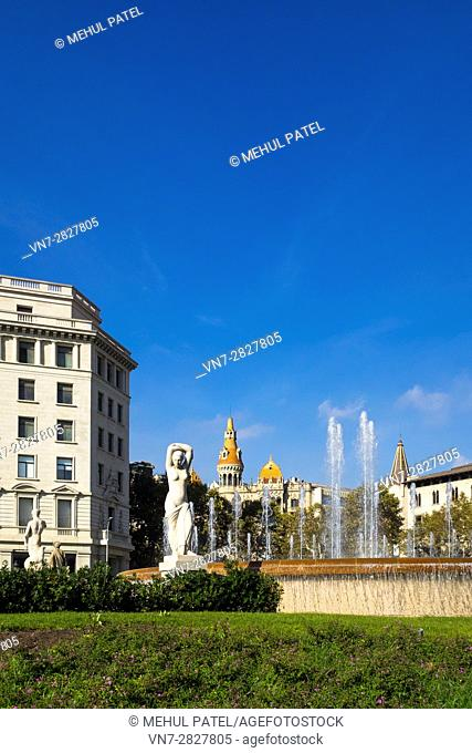 Sculpture and fountain at Plaça de Catalunya, Barcelona - Catalonia, Spain. Plaça de Catalunya is a large square in central Barcelona regarded as the city...