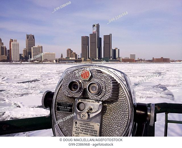 Coin operated high quality binoculars overlook the Detroit River and the Detroit skyline in winter from Windsor, Ontario, Canada