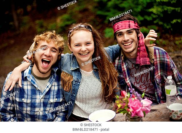 Friends laughing in forest