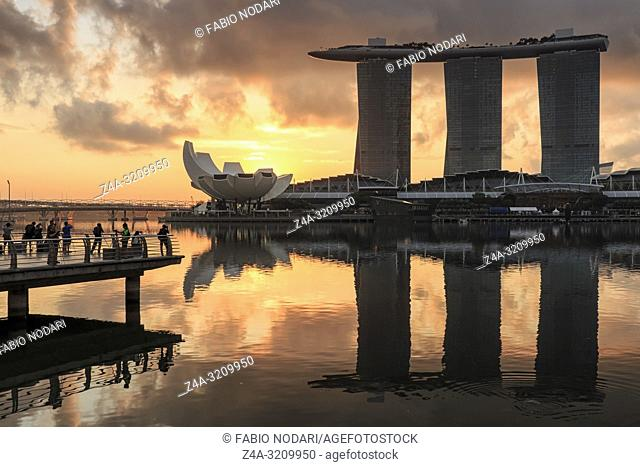 Sunrise in Singapore with a beautiful view of the Marina Bay Sands, Modern Art Museum and other iconic buildings
