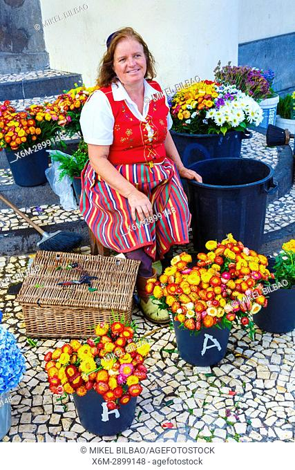 Woman selling flowers close to Mercado dos lavradores (Farmers market). Funchal, Madeira, Portugal, Europe