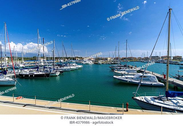 Sailing and motor boats are anchored in the harbour, Marina di Pisa, Tuscany, Italy