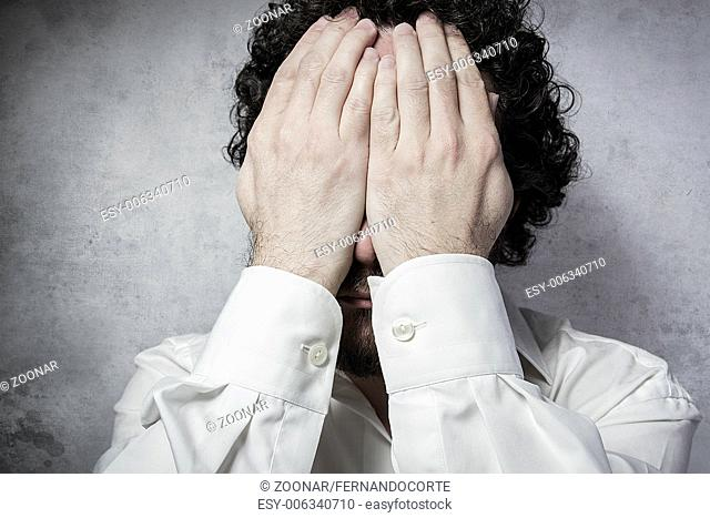 Businessman covering his eyes, man in white shirt with funny expressions