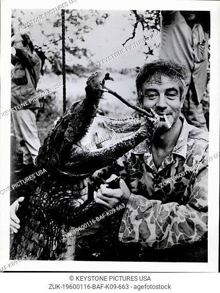 1983 - This isn't the 'alligator waltz', even if one of this pair is an apparently grinning gator. The fellow nonchalantly smoking the cigarette is merely...