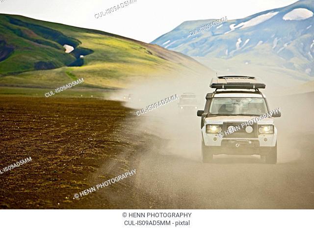SUV driving through dusty landscape on the Icelandic highlands, Domadalur, Fjallabak, Iceland