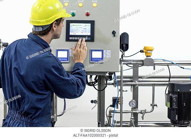 Skilled worker operating industrial equipment