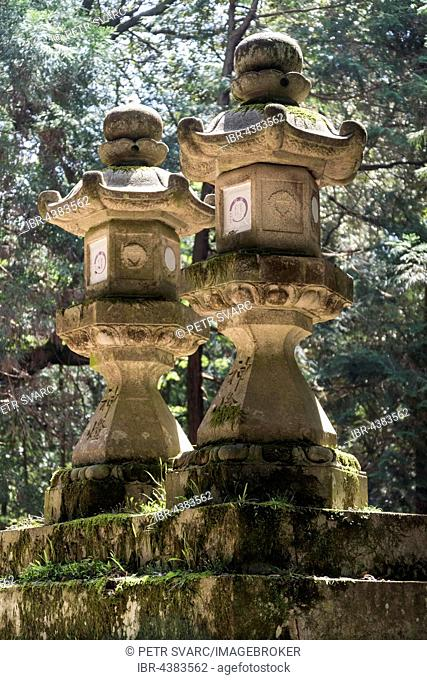 Toro, stone lanterns, along the path to Kasuga Taisha Shrine in Nara, Japan