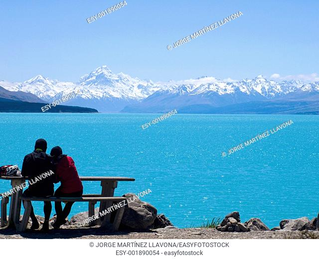 Pukaki Lake  Cyclist Couple
