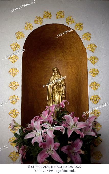A golden sculpture of the Our Lady of Guadalupe is displayed in Casa de los Frailes hotel in Oaxaca