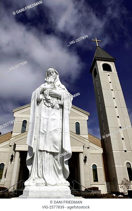 Statue of Saint Clare of Assisi outside the large Saint Clare of Assisi Church in Woodbridge Ontario, Canada. Saint Clare of Assisi is an Italian saint and one...