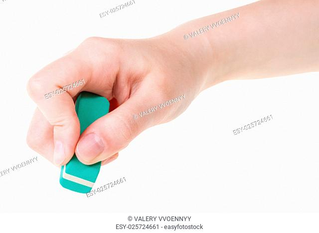 hand with new green rubber eraser close up isolated on white background