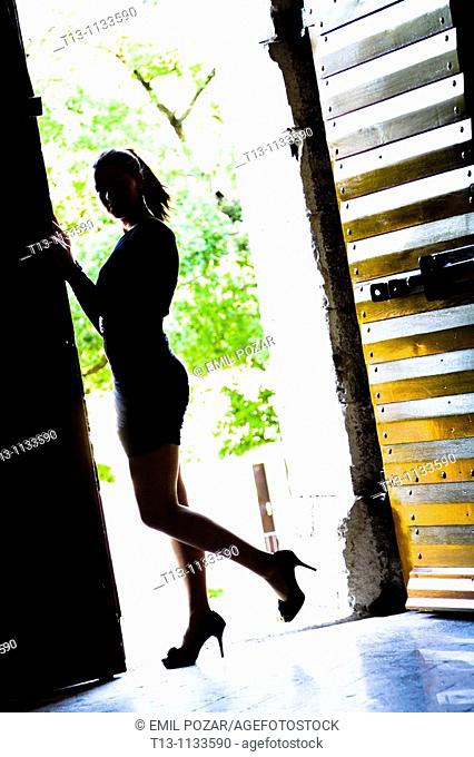 Silhouette of young woman on the entrance