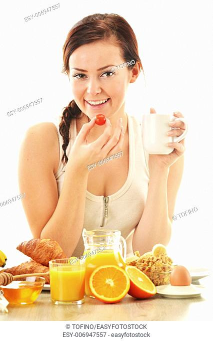 Young woman having breakfast. Balanced diet