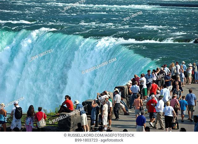 Tourists At Horseshoe Falls Niagara Waterfalls From Table Rock Ontario Canada