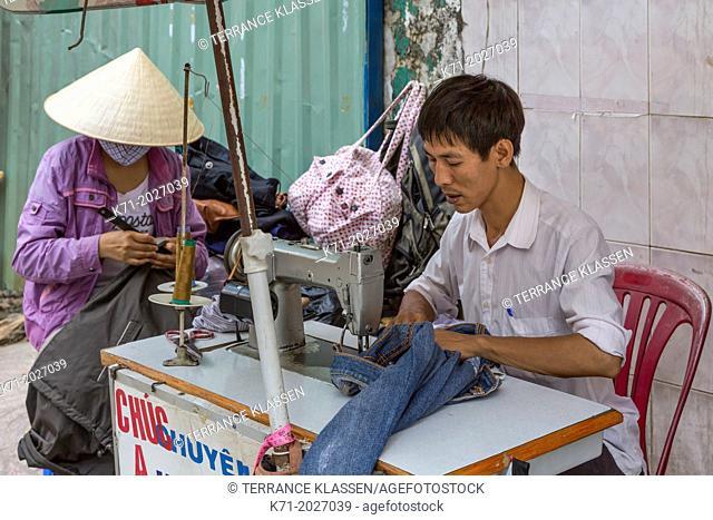 A streetside sewing shop in downtown Saigon, Ho Chi Minh City, Vietnam, Asia