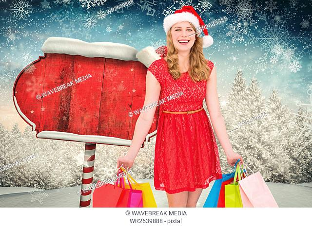 Beautiful woman in santa costume holding shopping bags