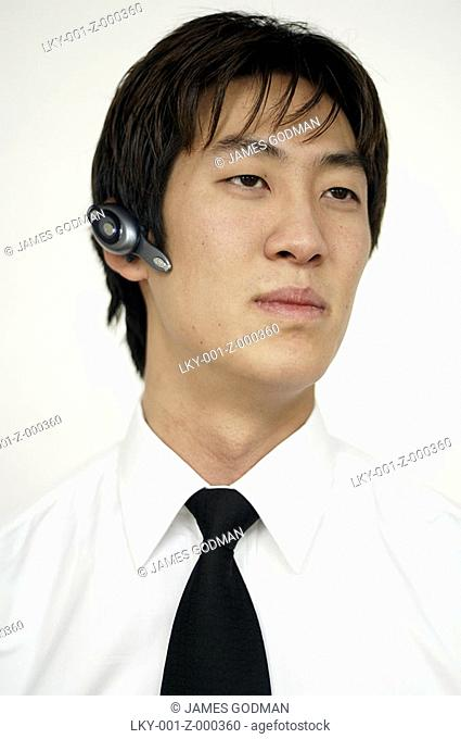 Portrait of man wearing hands-free device
