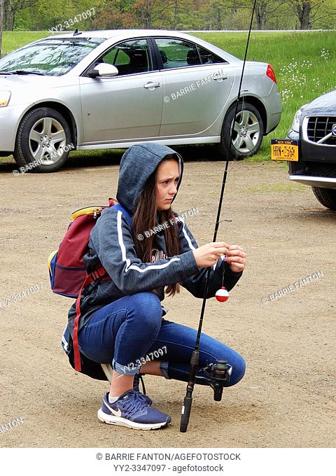7th Grade Girl Assembling Fishing Pole, Allegany State Park, Salamanca, New York, USA