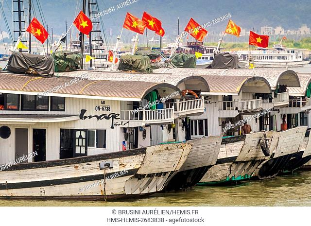 Vietnam, Gulf of Tonkin, Quang Ninh province, Ha Long Bay (Vinh Ha Long) listed as World Heritage by UNESCO (1994), tourist sampans flying the Vietnamse flag at...