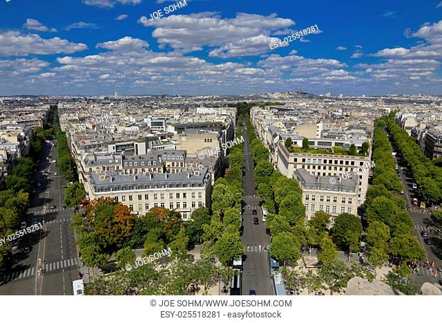PARIS, FRANCE, EUROPE -Aerial view of Paris, France as seen from the Arch of Triumph on a sunny day with white puffy clouds, shot August 4, 2015