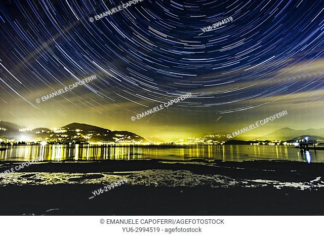 trails of stars on Lake Maggiore, Italy