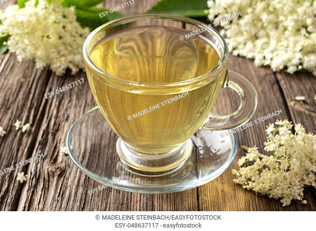 Herbal tea with elder flowers on a rustic background