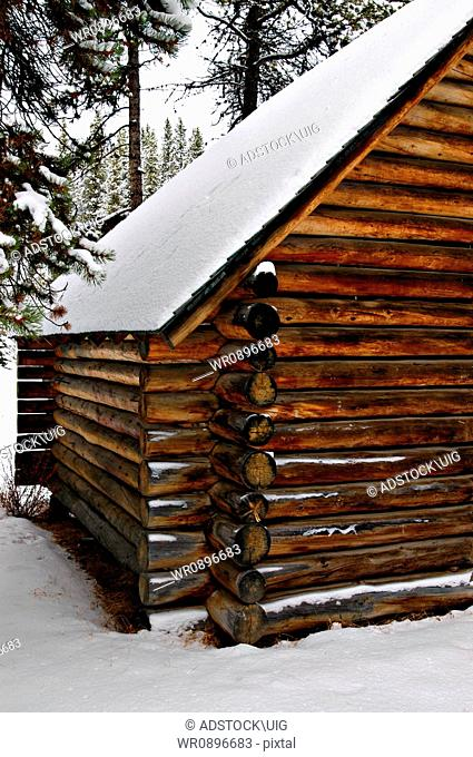 A snow covered log building at Maligne Lake in Jasper National Park