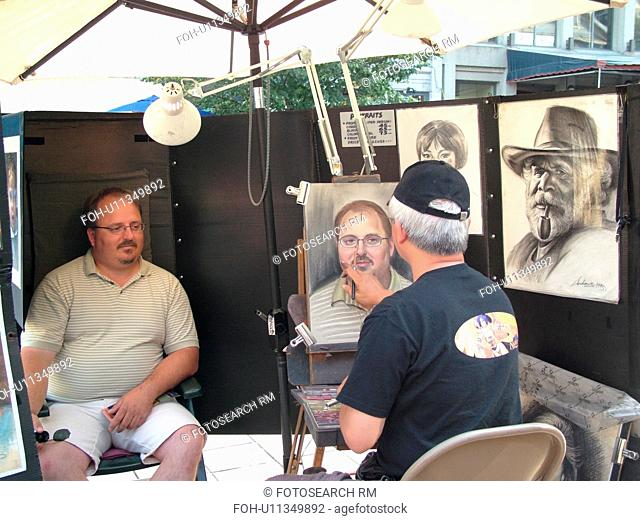 Montreal, Canada, QC, Quebec, Old Port, Old Montreal, Place Jacques Cartier, street artist sketching a man's portrait