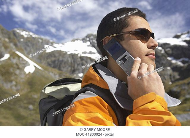 Man using walkie-talkie in mountains