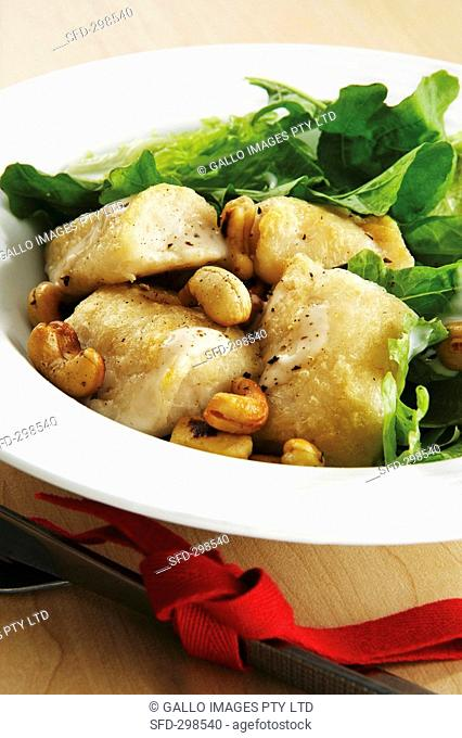 Fish with lettuce, cashew nuts and cheese dressing