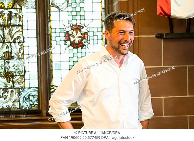 09 June 2019, Saarland, Saarbrücken: Uwe Conradt (CDU) stands laughing in the town hall after winning the run-off election for the Lord Mayor of Saarbrücken