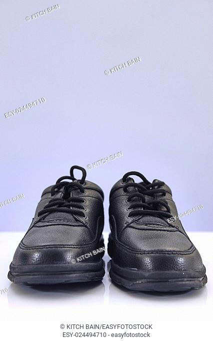 A studio photo of black walking shoes
