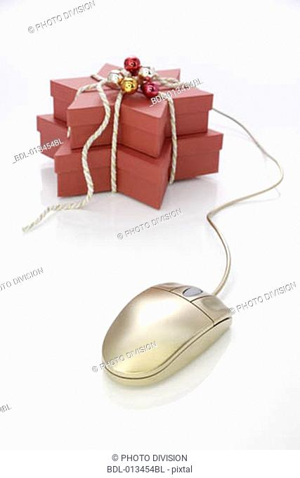 still life of computer mouse and christmas presents for online shopping