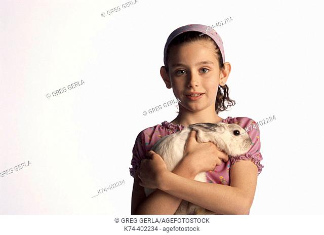 image of young girl with bunny rabbit
