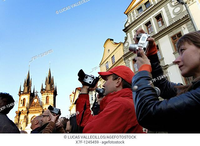 People in front of Astronomical Clock taking photos and filming  And the Tyn church in background  The Old Town Square Prague  Czech Republic