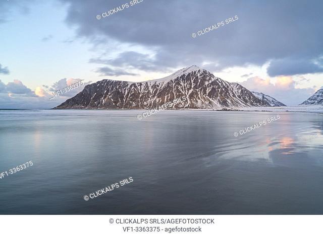 Skagsanden beach and Knubban peak in winter at sunset. Flakstad, Nordland county, Northern Norway, Norway