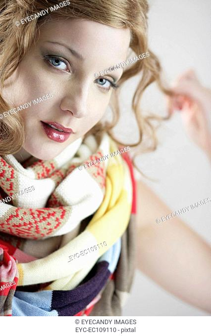 Portrait of a beautiful young woman with scarf around her neck