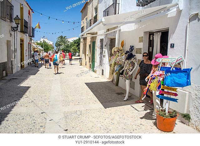 Tourists walking down the main street on the island of Tabarca Spain