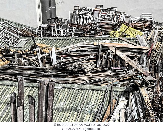Secong-hand planks, window frames and doors. Stored outdoors on a rooftop. Cape Town, South Africa