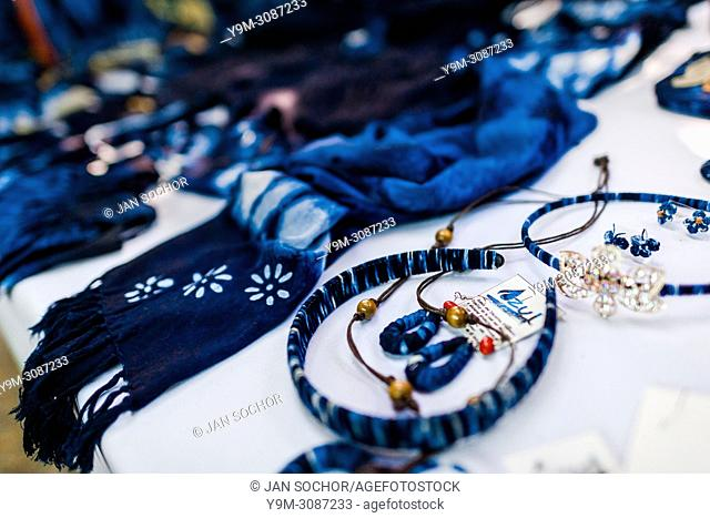 Indigo-dyed clothes and fashion accessories are seen placed on a table in an artisanal clothing workshop in Santiago Nonualco, El Salvador, 6 April 2018