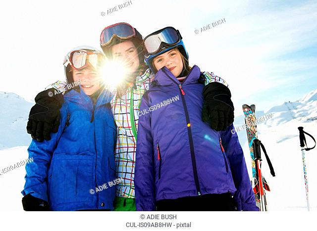 Portrait of brother and sisters in snow, Les Arcs, Haute-Savoie, France