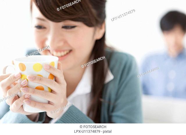Young Woman Having Tea