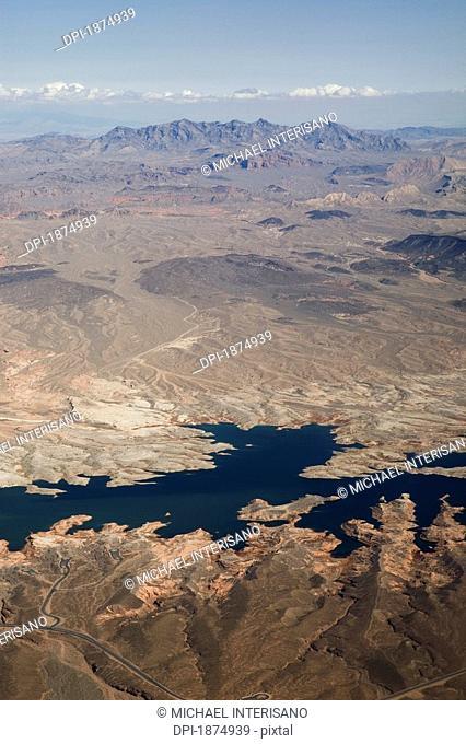 Las Vegas, Nevada, United States Of America, Aerial View Of Desert, River And Mountains With Snow Capped Mountains In Background