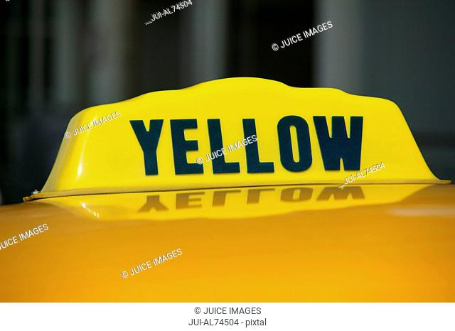 Detail view of a yellow taxi cab sign