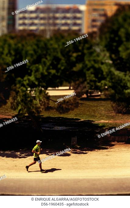 Runner at the old river bed Turia, Valencia, Spain
